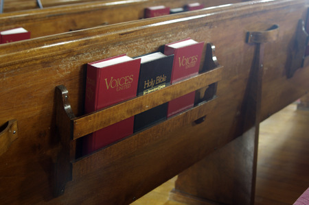 hymn: A Bible and song books in a church pew
