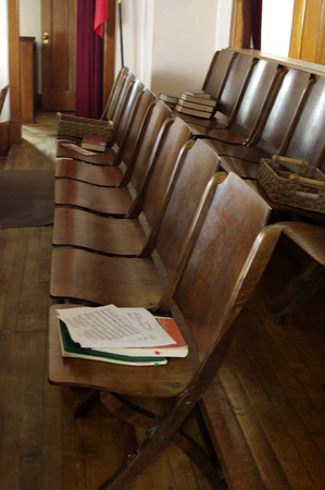 Wooden seats in a church choir Stock Photo