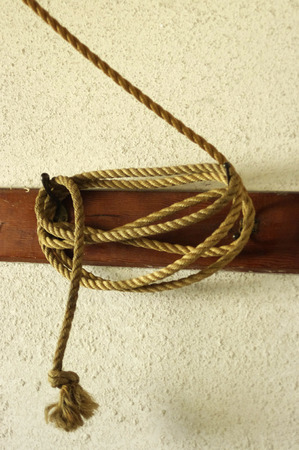 twined: Rope wrapped around a peg Stock Photo