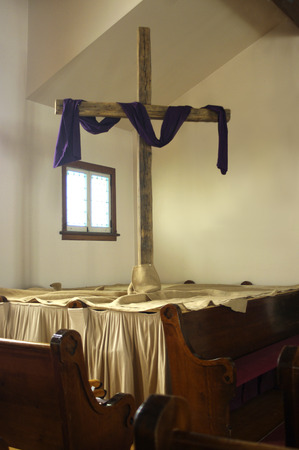 pews: A wooden cross in a church Editorial