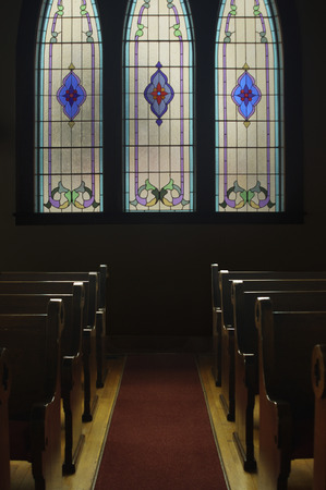 pews: A stained glass window in a church