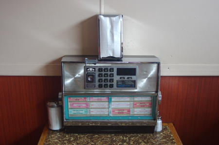old fashioned juke box on a diner table