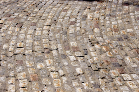 rough road: curved cobble stone street Stock Photo