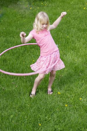 girl in pink hula hopping