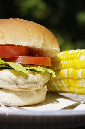 cob: chicken burger with corn on the cob