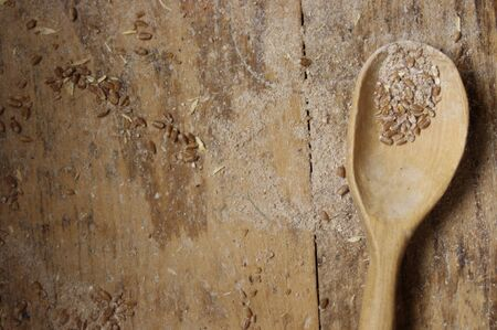 wooden baking spoon with wheat on wood table top Reklamní fotografie