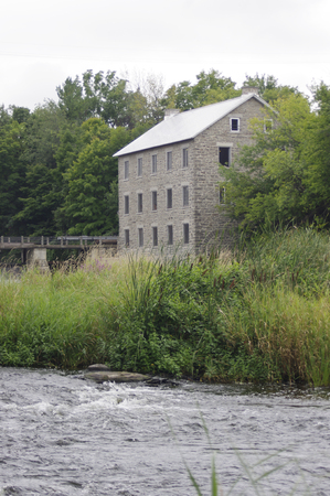 antique factory: old stone building on river