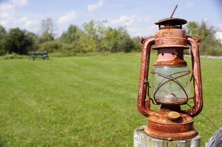 red oil lamp: rusty red antique oil lantern