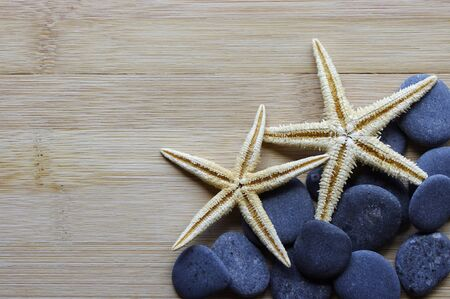 star fish: River stones and star fish on wood background