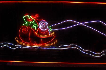 clause: Santa Clause in sled in lights