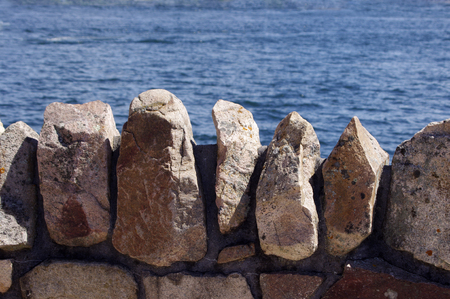 pointy: pointy rock wall at water