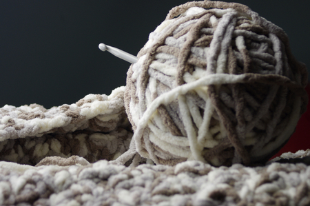 Neutral colored yarn with crochet hook