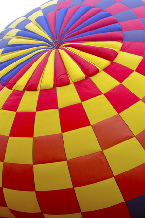 red, blue, yellow hot air balloon checker pattern