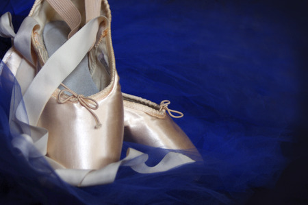 new pink ballet Pointe shoes with blue tutu on black Imagens