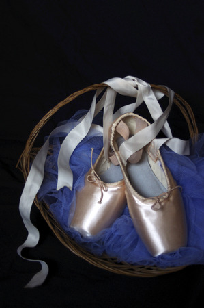 moody new pink Pointe ballet shoes in basket with blue tutu