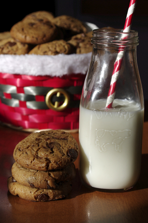 Christmas cookies in basket with milk and red paper straw
