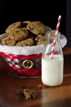 Moody Christmas cookies with crumbs  with milk and red paper straw
