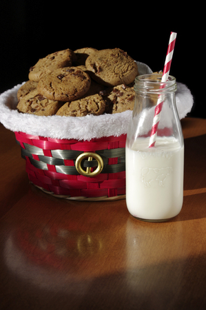 Christmas cookies with milk and red paper straw Stock Photo