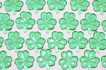 Glass shamrocks on white
