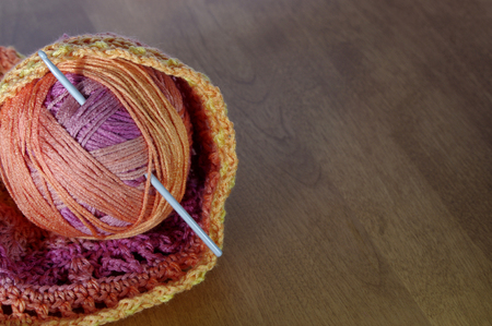 warm toned yarn with crochet hook with copy space