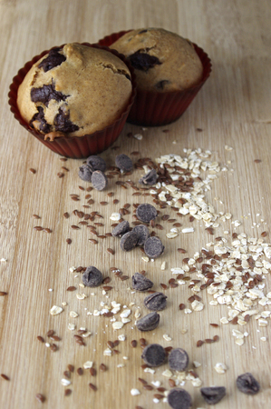 Homemade muffins with oats and seeds on wooden table Stock Photo