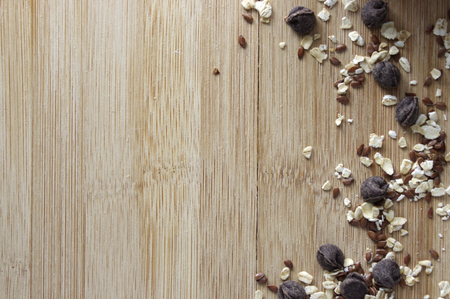 Oats, flax seeds and chocolate chips  seeds on wooden