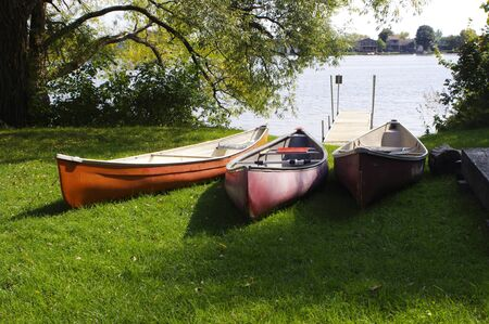 three canoes at waters edge