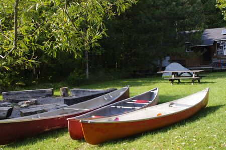 three canoes at on lawn at camp Stock Photo