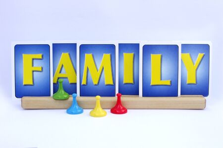 word family in cards with game pieces on white