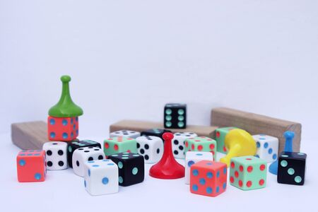 board game pieces on white background