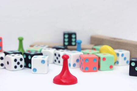 red board game mover in front of out of focus game pieces Stock Photo