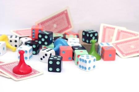 collection of board game movers, dice and cards Stock Photo