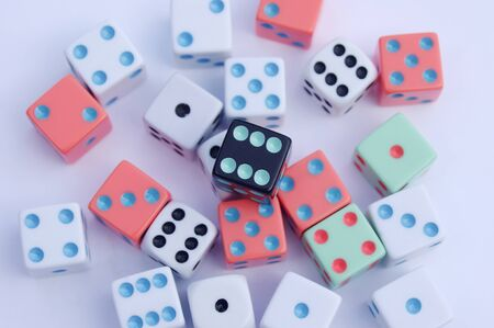different colored dice on white background