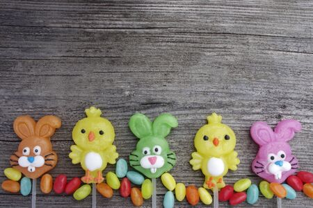 Easter bunny lollipops on wooden background with copy space 写真素材