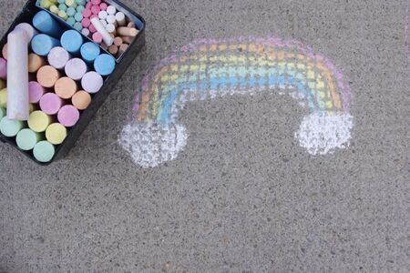 container full of rainbow coloured sidewalk chalk 写真素材