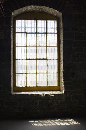 old window in stone building in sunlight Stok Fotoğraf - 142190521