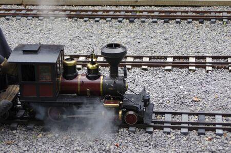miniature steam train engine on tracks