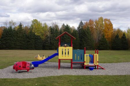 empty playground equipment in park in fall Stok Fotoğraf