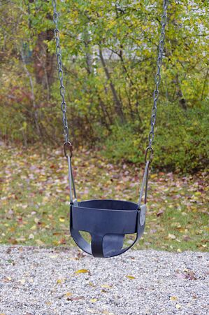 empty baby swing in park in autumn Stok Fotoğraf - 143463105