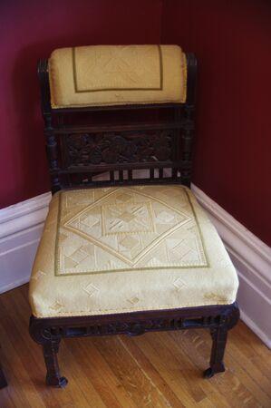 white antique wooden sitting chair