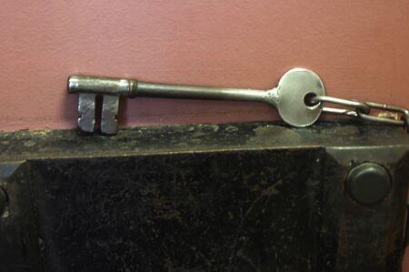 display of antique prison key on metal surface Stok Fotoğraf - 143781328