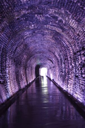 old brick tunnel with light at the end