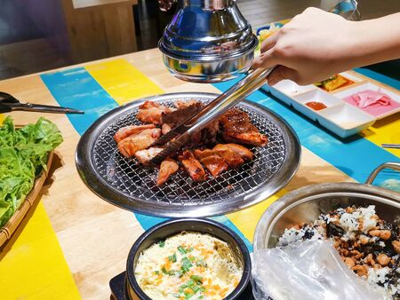 Grilling barbecue chicken in Korean restaurant, Korean Food
