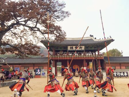 Korean traditional warriors / soldiers dance in front of the palace entrance (Hwaseong Haenggung)