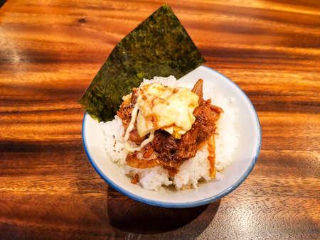 Teriyaki chicken rice bowl with mayonnaise and seaweed, Japanese food style