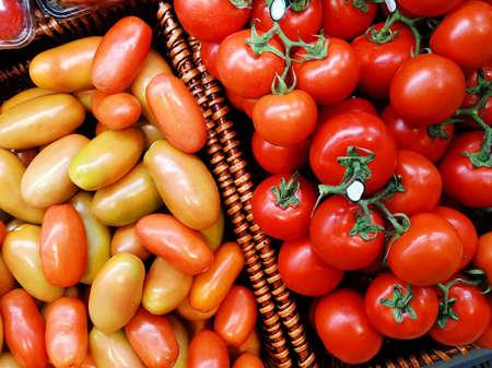 Fresh red, orange and yellow tomatoes in box