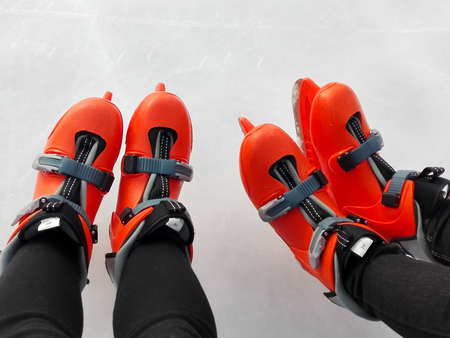Orange Ice Stake Shoes on Top of Ice, Two pairs 版權商用圖片