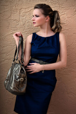 leather belt: Woman with handbag Stock Photo