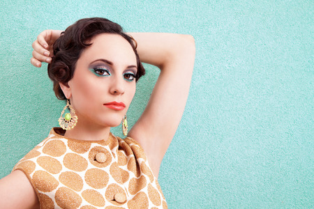 Retro woman with make up and jewelry with green copy space photo