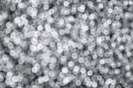 Abstract sparkling silver defocused bokeh background photo